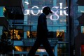 A pedestrian walks past the Google offices in Cambridge, Massachusetts. The EU has warned Google it may face more fines this year. Photo: Reuters