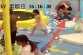 The man and woman grapple in the shopping centre play area as a young child runs to safety. Photo: Handout