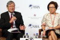Andrew Sheng and Laura Cha Shih May-lung speak at a financial cooperation conference organised by Hong Kong Monetary Authority and Boao Forum for Asia in Central in July, 2016. Photo: K. Y. Cheng