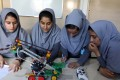 Afghan schoolgirls work on robot at their school in Herat, having been denied US visas to contest a robotics competition. Photo: EPA
