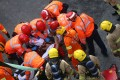 Rescue workers treat one of the men at the scene of the accident in Hung Hom. Photo: David Wong
