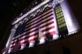 An American flag hangs on the front of the New York Stock Exchange. Photo: AP/Peter Morgan