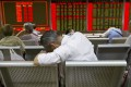 More than 2,800 stocks in Shanghai and Shenzhen fell, with nearly 500 of them dropping by their daily 10 per cent limit on Monday. Photo: AP