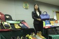 Catherine Yip, head of the intellectual property investigation bureau, with a few of the items that were seized. Photo: Edward Wong