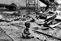 A bloodied child cries in the ruins of Shanghai's South Railway Station after Japanese bombing during the Sino-Japanese War. Photo: AP