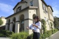 Alisha Chen, an agent in Irvine who specialises in buying houses for Chinese investors, checks her listings while touring homes for sale in Chino, California. Photo: MCT
