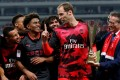 Arsenal's Petr Cech celebrates with the trophy and his teammates after the match. Photo: Reuters