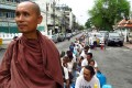 Dadodin Patavatto a Buddhist monk, leads a silent march to the prime minister's office in Bangkok to demonstrate against a proposed coal power plant in southern Thailand. The plans for an 800-megawatt coal power plant have sparked an outcry in the typically tranquil Krabi province, famed for its white sand and picturesque limestone cliffs. Photo: AP