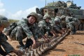 PLA soldiers prepare to fit a tank track at the Zhurihe training base in Inner Mongolia. Photo: SCMP Pictures