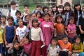 Teenage volunteer teachers from Hong Kong with children they taught in Nepal. Photo: Mabel Sieh
