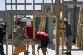 Workers install wall frames inside of a home under construction at the M/I Homes Inc. Bougainvillea Place housing development in Ellenton, Florida. New home sales in the US rose to their highest level in three months. Photo: Bloomberg
