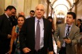 """Senator John McCain leaves the US Senate chamber after he stunned fellow senators by casting the decisive """"no"""" vote against the repeal of Obamacare, long-desired by his Republican colleagues. Photo: AFP"""
