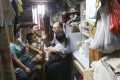 Secretary for Transport and Housing Frank Chan Fan visits a cramped home in Sham Shui Po. Photo: David Wong
