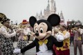 Mickey Mouse mouse is joined by a marching band at Shanghai Disney Resort . Photo: Bloomberg