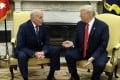 New White House Chief of Staff John Kelly talks with President Donald Trump after being privately sworn in. Photo: AP