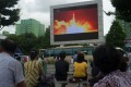 People watch as coverage of a North Korean intercontinental ballistic missile test is displayed on a screen in a public square in Pyongyang, on July 29. Photo: AFP