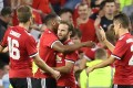 Manchester United midfielder Juan Mata celebrates with teammates after scoring the winning goal during the pre-season friendly against Sampdoria in Dublin. Photo: AFP