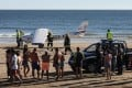 People look as emergency services and police inspect a plane that landed in an emergency on Sao Joao beach on Costa de Caparica in Almada, Portugal, on August 2, 2017. Two people were killed in the incident. Photo: EPA