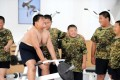 Obese Chinese children exercise in a fitness centre during a military training summer camp at the Shenyang Artillery College in Shenyang city, northeast China's Liaoning province. Photo: Imaginechina