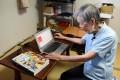 Masako Wakamiya use her laptop in her home in Fujisawa. Photo: AFP