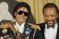 """In this 1984 file photo, Michael Jackson, left, holds eight awards as he poses with Quincy Jones at the Grammy Awards in Los Angeles. Jackson's estate announced on August 7, 2017, that a 3D version of his iconic """"Thriller"""" video will debut at the Venice Film Festival, which begins on August 30. Photo: AP"""