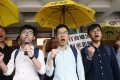 Activists (from left) Joshua Wong, Nathan Law and Alex Chow outside court on Wednesday. Photo: Dickson Lee