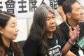"""Lau Siu-lai, """"Long Hair"""" Leung Kwok-hung and Edward Yiu, three of the four disqualified lawmakers, at a press conference at the Legislative Council building on Wednesday. Photo: David Wong"""