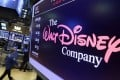 The Walt Disney Company logo appears on a screen above the floor of the New York Stock Exchange earlier this week. Photo: AP