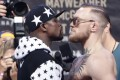 Floyd Mayweather Jnr (left) and Conor McGregor face off for photos during a news conference at Barclays Centre in New York. Photo: AP