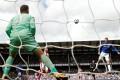 Wayne Rooney scores Everton's winner against Stoke goalkeeper Jack Butland. Photo: Reuters