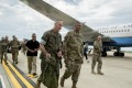Joint Chiefs Chairman General Joseph Dunford is greeted by United States Forces Korea Commander General Vincent Brooks (centre right) as he arrives at Osan Air Base in Pyeongtaek, South Korea. Photo: AP
