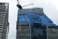 The uncovering of this new hotel building, with its unusual design, sparked fears it could be about to fall. Photo: Patipat Janthong/Bangkok Post