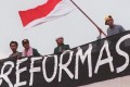 Indonesian students call for Suharto to go. Photo: AFP