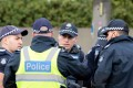 Australian police gather at a crime scene. Photo: AFP