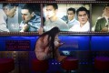 A woman looks at her mobile phone at the entrance of a cinema in Beijing on August 30, 2016. Photo: AFP PHOTO