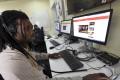 BBC programmer Busayo Iruemiode checks a website in Pidgin in Lagos, Nigeria, on Saturday. Photo: AFP
