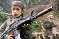 Children from the Karen National Union insurgent army hold assault weapons during celebrations marking the 51st anniversary of the army's rebellion against the Myanmar Junta in 2000. Photo: AFP