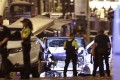 Police officers stand next to the van involved on an attack in Las Ramblas in Barcelona, Spain, Thursday, Aug. 17, 2017. Spanish police have confirmed they shot down Younes Abouyaaqoub, suspected driver of the van used in the terror attack. Photo: AP