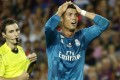Real Madrid's Cristiano Ronaldo reacts after referee Ricardo de Burgos shows a second yellow card during the Spanish Supercup. Photos: AP