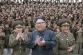 North Korean leader Kim Jong-un flanked by military officers. Photo: AP