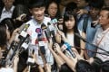 Disqualified lawmakers Sixtus Baggio Leung Chung-hang and Yau Wai-ching (centre) address media at the Court of Final Appeal. Photo: Felix Wong