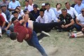 A file picture of two men taking part in a traditional wrestling fight during a wedding in Hami, Xinjiang. Photo: Reuters