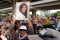 Supporters of ousted former Thai prime minister Yingluck Shinawatra outside the Supreme Court in Bangkok. Photo: Reuters