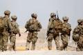 US troops walk outside their base in Uruzgan province, Afghanistan. Photo: Reuters