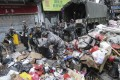 PLA soldiers clear the streets of debris in Macau. Photo: Edward Wong