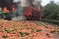 A fatal truck crash in Hunan left both vehicles in flames and a load of watermelons strewn across an expressway on Monday. Photo: Handout