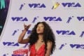 US rapper Lil Mama releases a bird from a cage on the red carpet at the MTV Video Music Awards. Picture: EPA
