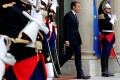 French President Emmanuel Macron waits for guests at Elysee Palace in Paris. Photo: Reuters
