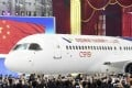 The first C919 passenger jet made by Comac is rolled out during a news conference at the company's factory in Shanghai, in November 2015. Photo: Reuters