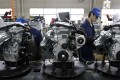 Employees weld engines on the assembly line of Zhejiang Geely Holding Group in Hangzhou, Zhejiang province March 30, 2010. Zhejiang Geely Holding Group, China's largest private-run car maker, agreed on Sunday to buy Ford Motor's Volvo car unit for $1.8 billion, the country's biggest overseas auto purchase. REUTERS/Steven Shi (CHINA - Tags: TRANSPORT BUSINESS) CHINA OUT. NO COMMERCIAL OR EDITORIAL SALES IN CHINA